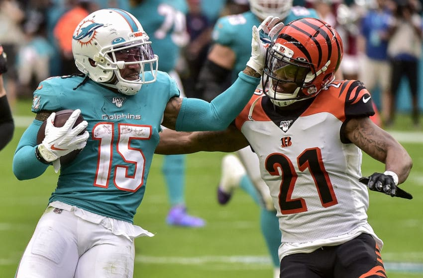 MIAMI, FLORIDA - DECEMBER 22: Albert Wilson #15 of the Miami Dolphins avoids being tackled by Darqueze Dennard #21 of the Cincinnati Bengals during the second quarter of the game at Hard Rock Stadium on December 22, 2019 in Miami, Florida. (Photo by Eric Espada/Getty Images)