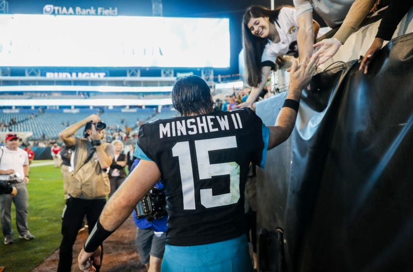JACKSONVILLE, FLORIDA - DECEMBER 29: Gardner Minshew II #15 of the Jacksonville Jaguars meets with fans after defeating the Indianapolis Colts in a game at TIAA Bank Field on December 29, 2019 in Jacksonville, Florida. (Photo by James Gilbert/Getty Images)