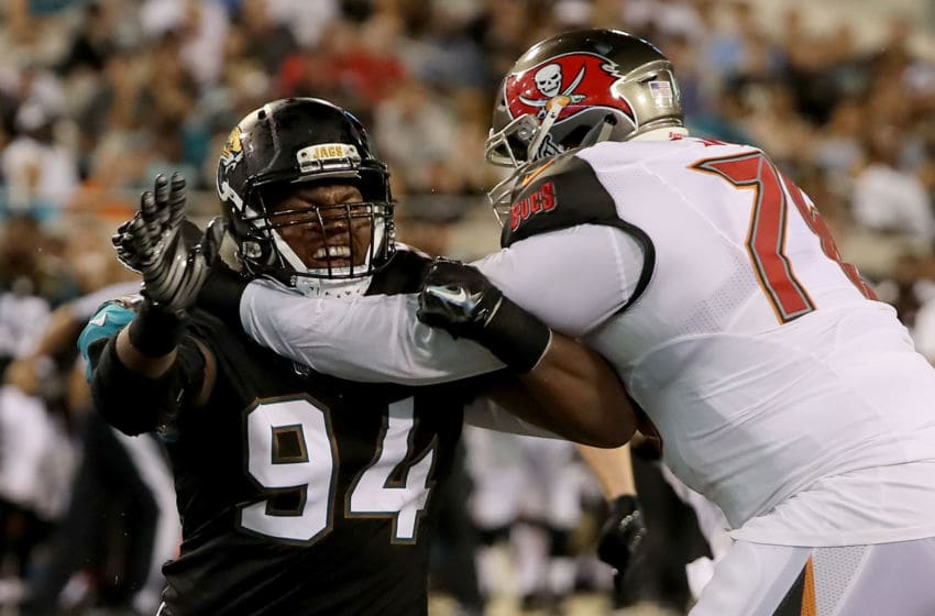 JACKSONVILLE, FL - AUGUST 17: Dawuane Smoot #94 of the Jacksonville Jaguars attempts to run past Donovan Smith #76 of the Tampa Bay Buccaneers during a preseason game at EverBank Field on August 17, 2017 in Jacksonville, Florida. (Photo by Sam Greenwood/Getty Images)