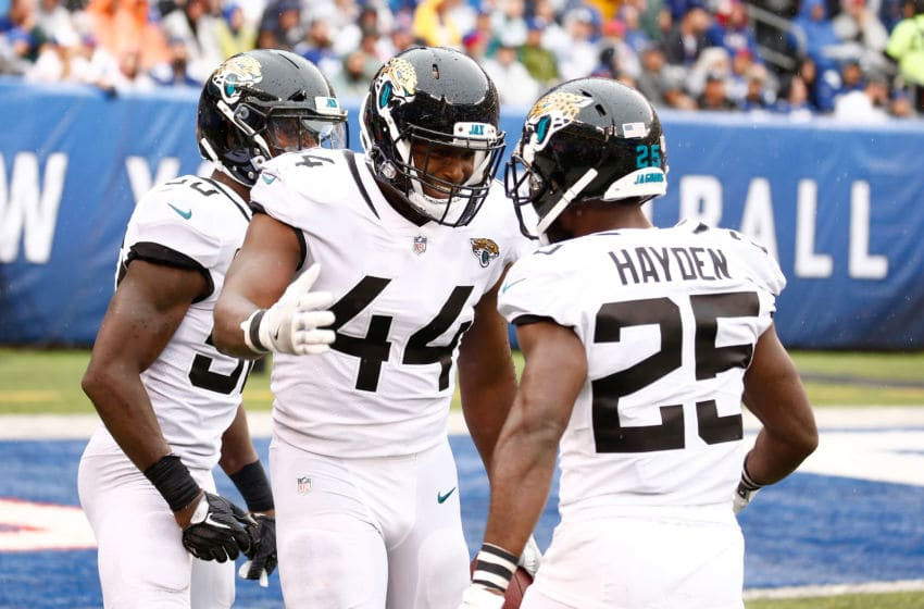 EAST RUTHERFORD, NJ - SEPTEMBER 09: Myles Jack #44 of the Jacksonville Jaguars celebrates with Telvin Smith #50 and D.J. Hayden #25 after interception a pass by Eli Manning #10 of the New York Giants in the fourth quarter and scoring a touchdown at MetLife Stadium on September 9, 2018 in East Rutherford, New Jersey. (Photo by Jeff Zelevansky/Getty Images)