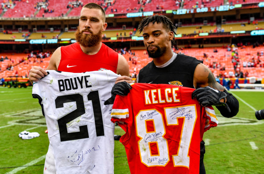 KANSAS CITY, MO - OCTOBER 7: Travis Kelce #87 of the Kansas City Chiefs and A.J. Bouye #21 of the Jacksonville Jaguars trade jerseys following the game at Arrowhead Stadium on October 7, 2018 in Kansas City, Missouri. (Photo by Peter Aiken/Getty Images)