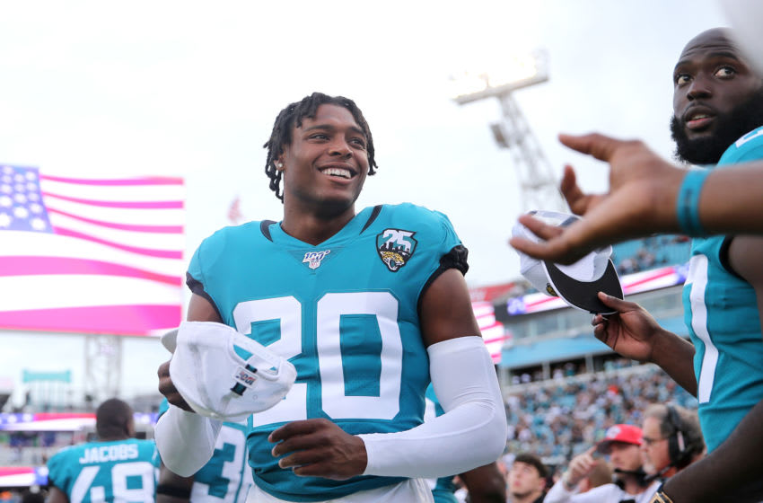 JACKSONVILLE, FLORIDA - AUGUST 15: Jalen Ramsey #20 and Leonard Fournette #27 of the Jacksonville Jaguars look on before the start of a preseason game versus the Philadelphia Eagles at TIAA Bank Field on August 15, 2019 in Jacksonville, Florida. (Photo by James Gilbert/Getty Images)