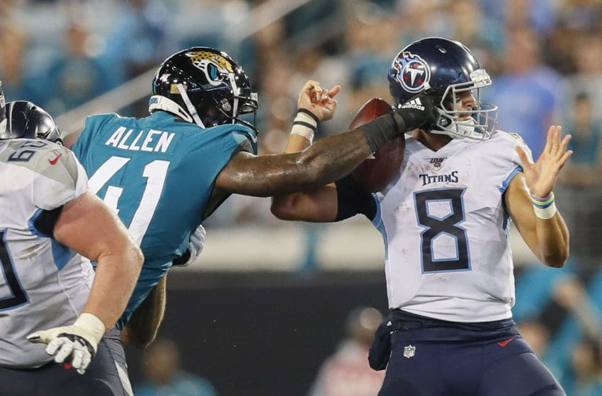 JACKSONVILLE, FLORIDA - SEPTEMBER 19: Josh Allen #41 of the Jacksonville Jaguars forces a fumble by Marcus Mariota #8 of the Tennessee Titans during the fourth quarter of a game at TIAA Bank Field on September 19, 2019 in Jacksonville, Florida. (Photo by James Gilbert/Getty Images)