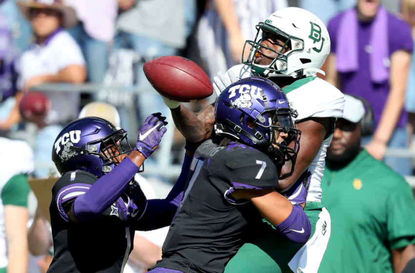 FORT WORTH, TEXAS - NOVEMBER 09: Denzel Mims #5 of the Baylor Bears bobbles a pass against Tre'Vius Hodges-Tomlinson #1 of the TCU Horned Frogs and Trevon Moehrig #7 of the TCU Horned Frogs in the second half at Amon G. Carter Stadium on November 09, 2019 in Fort Worth, Texas. (Photo by Tom Pennington/Getty Images)