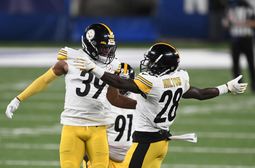 EAST RUTHERFORD, NEW JERSEY - SEPTEMBER 14: Minkah Fitzpatrick #39 reacts with Mike Hilton #28 of the Pittsburgh Steelers during the second half against the New York Giants at MetLife Stadium on September 14, 2020 in East Rutherford, New Jersey. (Photo by Sarah Stier/Getty Images)