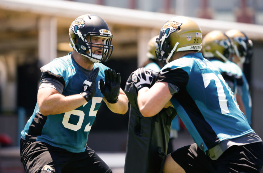 JACKSONVILLE, FL - MAY 16: Brandon Linder #65 of the Jacksonville Jaguars works out during rookie minicamp at Everbank Field on May 16, 2014 in Jacksonville, Florida. (Photo by Rob Foldy/Getty Images)