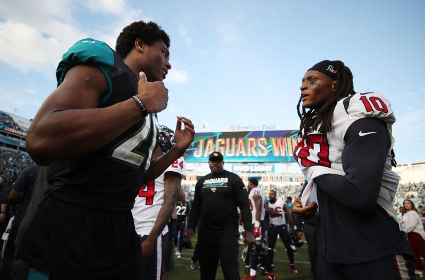 JACKSONVILLE, FL - DECEMBER 17: Jalen Ramsey #20 of the Jacksonville Jaguars (L) greets DeAndre Hopkins #10 of the Houston Texans on the field after the Jaguars defeated the Houston Texans 45-7 at EverBank Field on December 17, 2017 in Jacksonville, Florida. (Photo by Logan Bowles/Getty Images)