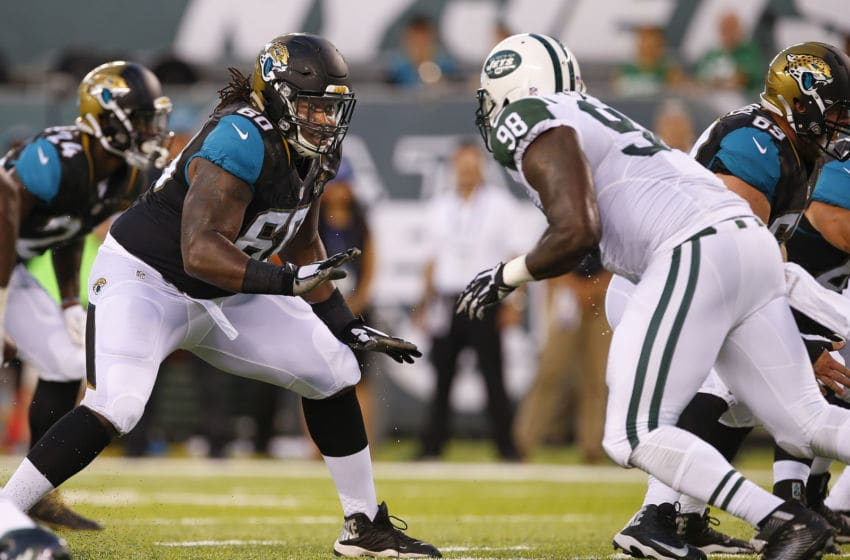 EAST RUTHERFORD, NJ - AUGUST 11: A.J. Cann #60 of the Jacksonville Jaguars in action against Jarvis Jenkins #98 of the New York Jets during the first quarter of an NFL preseason game at MetLife Stadium on August 11, 2016 in East Rutherford, New Jersey. (Photo by Rich Schultz/Getty Images)