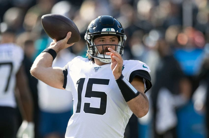 OAKLAND, CA - DECEMBER 15: Quarterback Gardner Minshew II #15 of the Jacksonville Jaguars warms up before the game against the Oakland Raiders at RingCentral Coliseum on December 15, 2019 in Oakland, California. (Photo by Jason O. Watson/Getty Images)