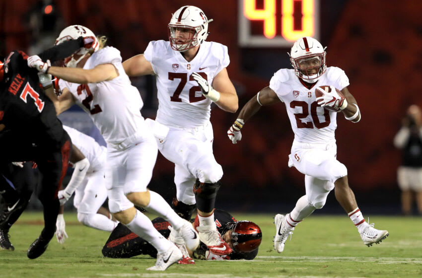 Walker Little #72 blocks for the Stanford Cardinal Bryce Love #20 (Photo by Sean M. Haffey/Getty Images)