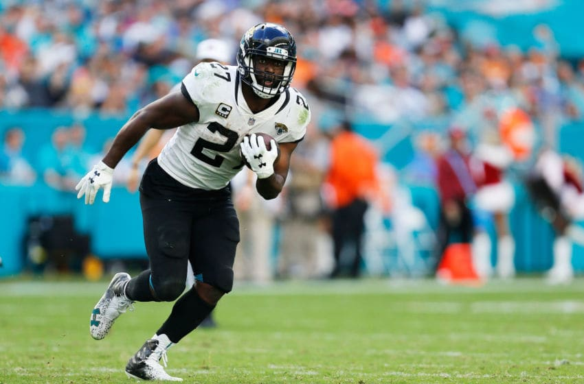 MIAMI, FLORIDA - DECEMBER 23: Leonard Fournette #27 of the Jacksonville Jaguars carries the ball against the Miami Dolphins in the second half at Hard Rock Stadium on December 23, 2018 in Miami, Florida. (Photo by Michael Reaves/Getty Images)