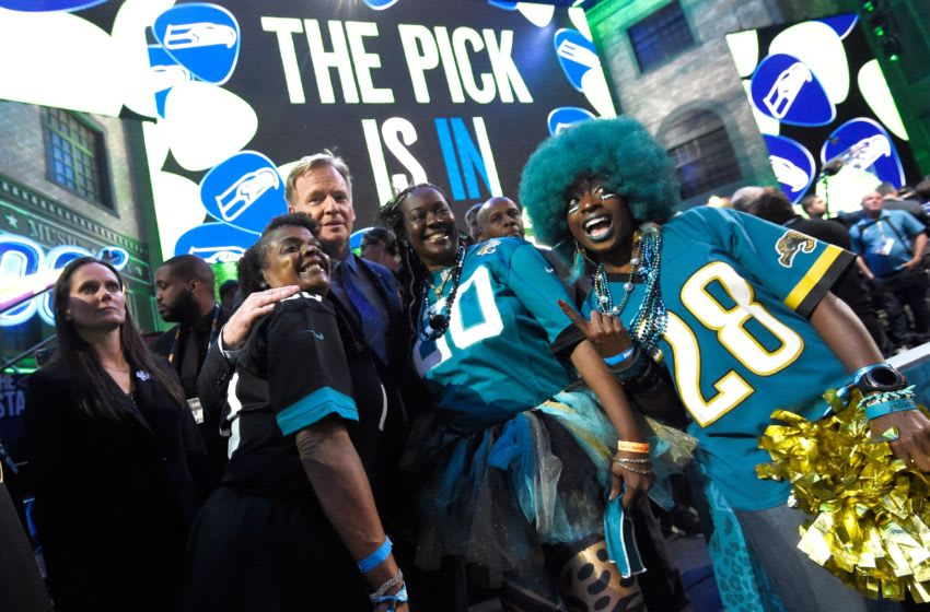 NFL Commisioner Roger Goodell poses with Jaguars fans during the first round of the NFL Draft Thursday, April 25, 2019, in Nashville, Tenn. Gw41772