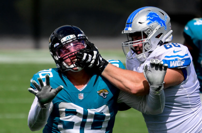 Oct 18, 2020; Jacksonville, Florida, USA; Jacksonville Jaguars defensive tackle Taven Bryan (90) rushes the passer as Detroit Lions guard Joe Dahl (66) is called for a penalty during the first half at TIAA Bank Field. Mandatory Credit: Douglas DeFelice-USA TODAY Sports