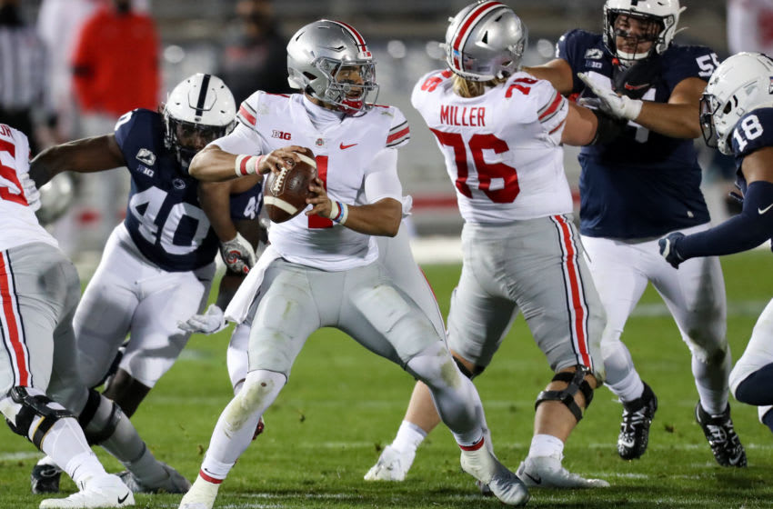 Oct 31, 2020; University Park, Pennsylvania, USA; Ohio State Buckeyes quarterback Justin Fields (1) looks to throw a pass during the third quarter against the Penn State Nittany Lions at Beaver Stadium. Mandatory Credit: Matthew OHaren-USA TODAY Sports