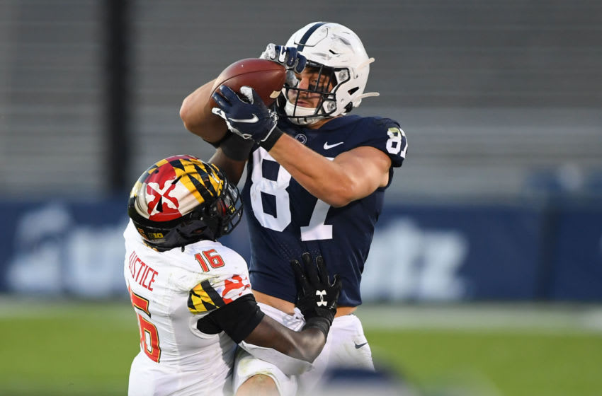 Nov 7, 2020; University Park, Pennsylvania, USA; Maryland Terrapins linebacker Ayinde Eley (16) breaks up a pass intended for Penn State Nittany Lions tight end Pat Freiermuth (87) during the second quarter at Beaver Stadium. Mandatory Credit: Rich Barnes-USA TODAY Sports