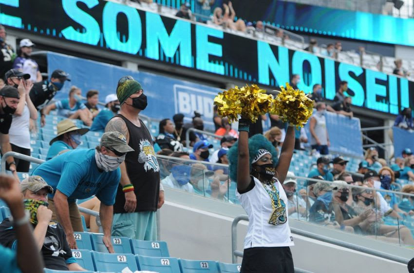 Socially distanced Jaguars fans cheer on the team late in the fourth quarter of play. The Jaguars came away with the victory with a final score of 20 to 27. The Jacksonville Jaguars hosted the Indianapolis Colts for the season-opening game at TIAA Bank Field Sunday, September 13, 2020. [Bob Self/Florida Times-Union]