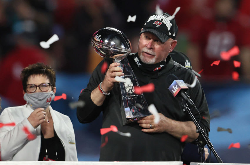 Feb 7, 2021; Tampa, FL, USA; Tampa Bay Buccaneers head coach Bruce Arians hoists the Vince Lombardi Trophy after defeating the Kansas City Chiefs in Super Bowl LV at Raymond James Stadium. Mandatory Credit: Matthew Emmons-USA TODAY Sports