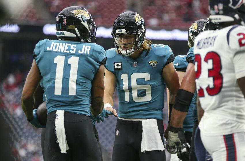 USA; Jacksonville Jaguars quarterback Trevor Lawrence (16) and wide receiver Marvin Jones (11) (Troy Taormina-USA TODAY Sports)