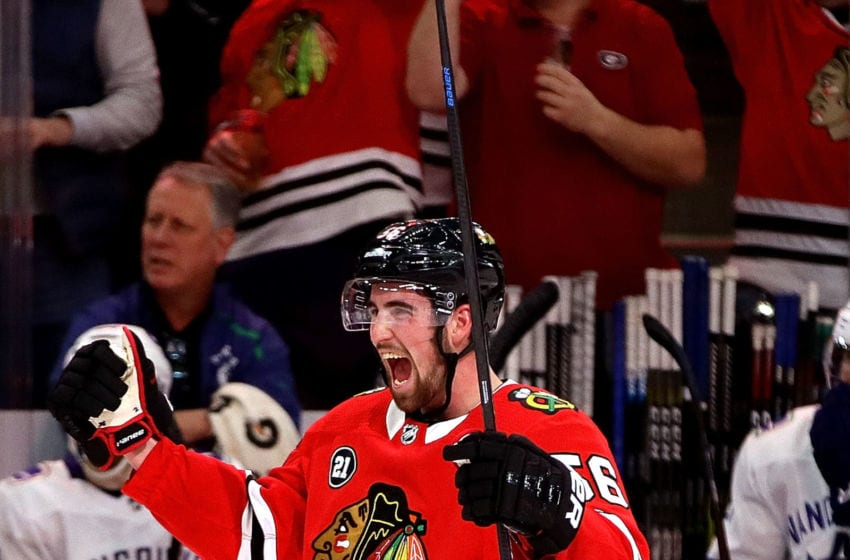 CHICAGO, ILLINOIS - MARCH 18: Erik Gustafsson #56 of the Chicago Blackhawks celebrates his game-tying goal in the third period against the Vancouver Canucks at the United Center on March 18, 2019 in Chicago, Illinois. The Canucks defeated the Blackhawks 3-2 in overtime. (Photo by Jonathan Daniel/Getty Images)
