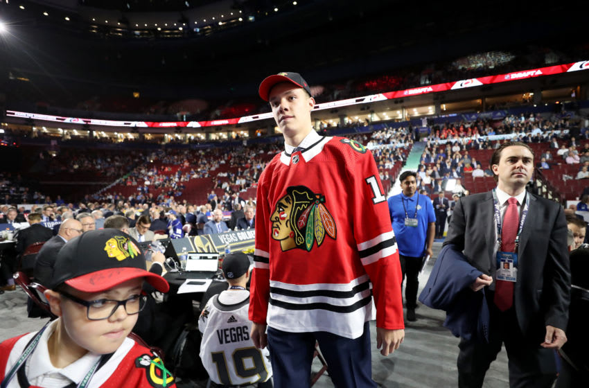 VANCOUVER, BRITISH COLUMBIA - JUNE 22: Alex Vlasic reacts after being selected 43rd overall by the Chicago Blackhawks during the 2019 NHL Draft at Rogers Arena on June 22, 2019 in Vancouver, Canada. (Photo by Bruce Bennett/Getty Images)