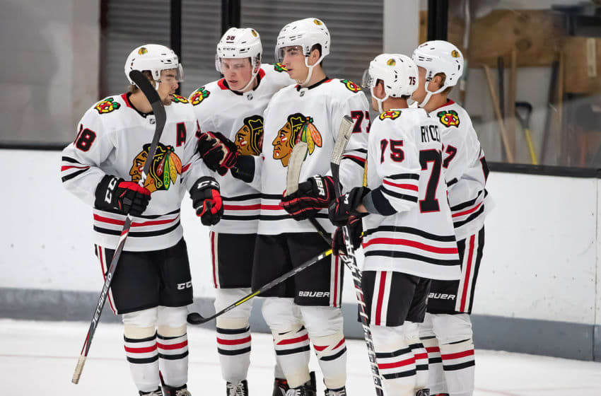 TRAVERSE CITY, MI - SEPTEMBER 10: Kirby Dach #77 of the Chicago Blackhawks celebrates a goal against the Minnesota Wild with teammates during Day-5 of the NHL Prospects Tournament at Centre Ice Arena on September 10, 2019 in Traverse City, Michigan. (Photo by Dave Reginek/NHLI via Getty Images)