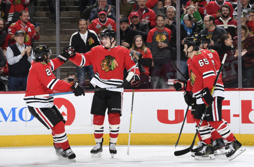 CHICAGO, IL - NOVEMBER 17: Kirby Dach #77 and Duncan Keith #2 of the Chicago Blackhawks celebrate after Dach scored against the Buffalo Sabres in the first period at the United Center on November 17, 2019 in Chicago, Illinois. (Photo by Bill Smith/NHLI via Getty Images)