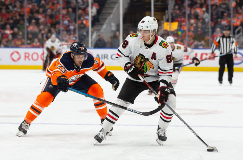 EDMONTON, AB - FEBRUARY 11: Riley Sheahan #23 of the Edmonton Oilers pursues Patrick Kane #88 of the Chicago Blackhawks at Rogers Place on February 11, 2020, in Edmonton, Canada. (Photo by Codie McLachlan/Getty Images)