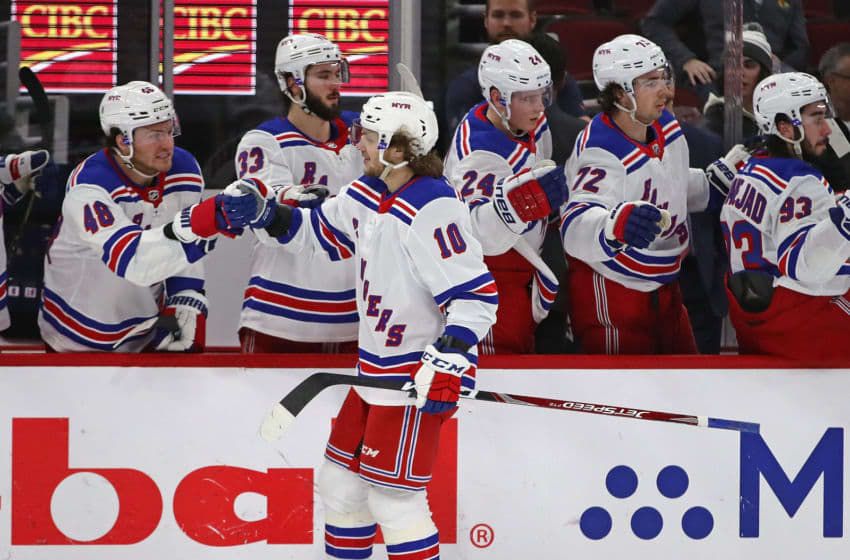 CHICAGO, ILLINOIS - FEBRUARY 19: Artemi Panarin #10 of the New York Rangers is congratulated by teammates after scoring a third period goal against the Chicago Blackhawks at the United Center on February 19, 2020 in Chicago, Illinois. The Rangers defeated the Blackhawks 6-3. (Photo by Jonathan Daniel/Getty Images)
