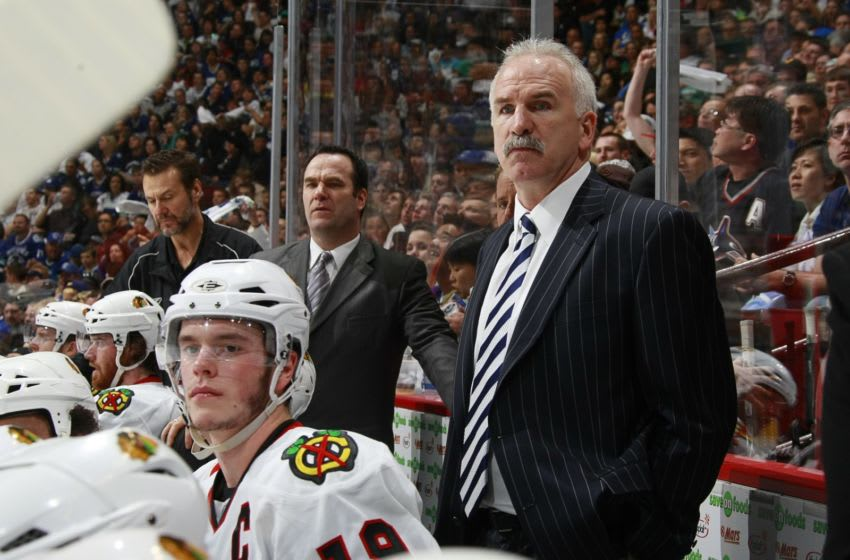 VANCOUVER, CANADA - MAY 9: Head coach Joel Quenneville of the Chicago Blackhawks looks on from the bench during Game Five of the Western Conference Semifinal Round of the 2009 Stanley Cup Playoffs against the Vancouver Canucks at General Motors Place on May 9, 2009 in Vancouver, British Columbia, Canada. (Photo by Jeff Vinnick/NHLI via Getty Images)