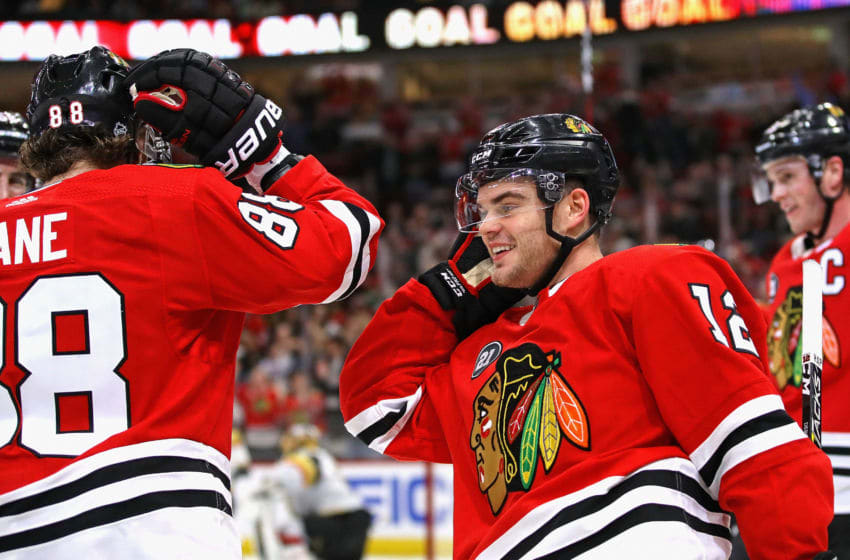 CHICAGO, ILLINOIS - JANUARY 12: Alex DeBrincat #12 of the Chicago Blackhawks celebrates his second goal of the game with Patrick Kane #88, who had the assist, against the Vegas Golden Knights at the United Center on January 12, 2019 in Chicago, Illinois. (Photo by Jonathan Daniel/Getty Images)