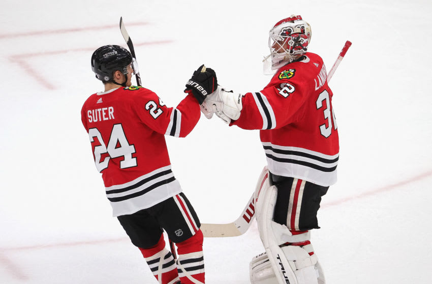 Pius Suter #24, Chicago Blackhawks, Kevin Lankinen #32 (Photo by Jonathan Daniel/Getty Images)