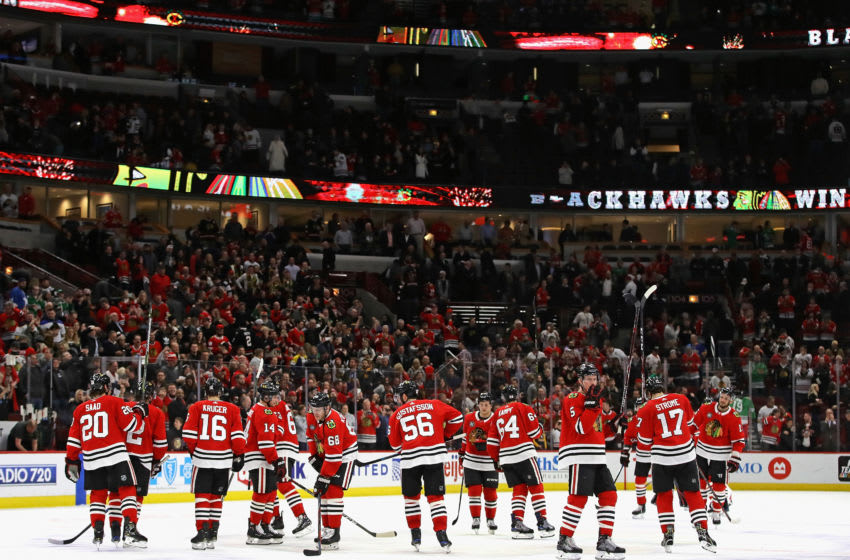 CHICAGO, ILLINOIS - MARCH 07: Members of the Chicago Blackhawks salute the crowd after a win over the Buffalo Sabres at the United Center on March 07, 2019 in Chicago, Illinois. The Blackhawks defeated the Sabres 5-4 in a shootout. (Photo by Jonathan Daniel/Getty Images)