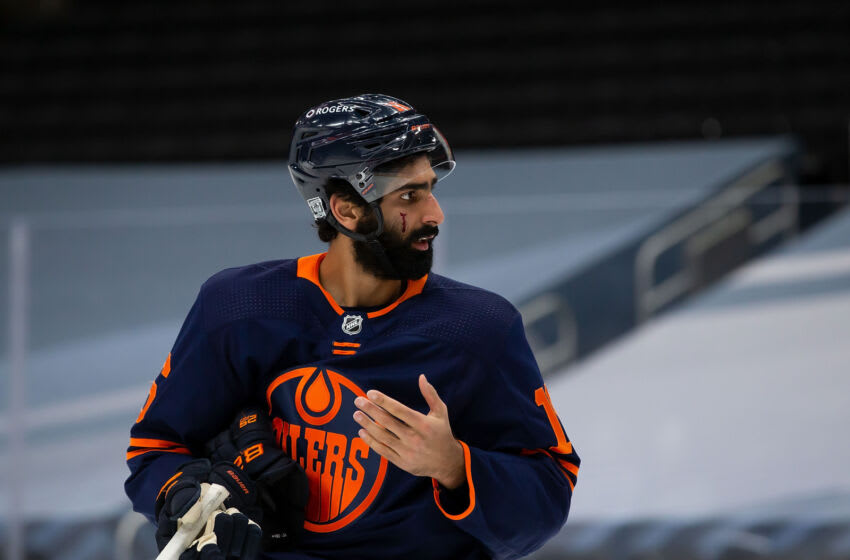EDMONTON, AB - FEBRUARY 17: Jujhar Khaira #16 of the Edmonton Oilers complains after receiving a cut to the face against the Winnipeg Jets at Rogers Place on February 17, 2021 in Edmonton, Canada. (Photo by Codie McLachlan/Getty Images)
