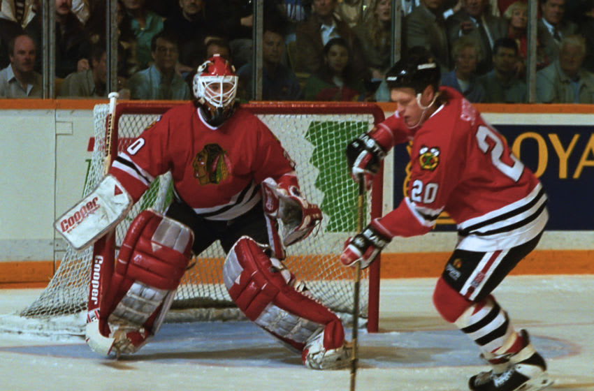 TORONTO, ON - APRIL 18: Ed Belfour #30 and Gary Suter #20 of the Chicago Blackhawks skate against the Toronto Maple Leafs during 1993-1994 NHL playoff game action at Maple Leaf Gardens in Toronto, Ontario, Canada. (Photo by Graig Abel/Getty Images)