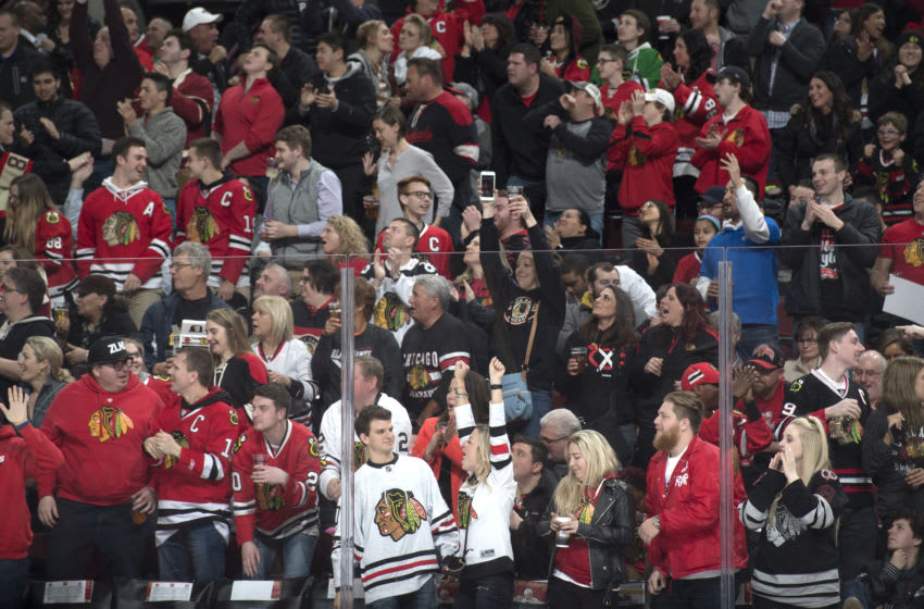 CHICAGO, IL - MARCH 29: Fans cheer after the Chicago Blackhawks scored against the Winnipeg Jets in the second period at the United Center on March 29, 2018 in Chicago, Illinois. (Photo by Bill Smith/NHLI via Getty Images)