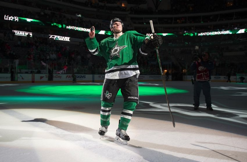 Mar 11, 2016; Dallas, TX, USA; Dallas Stars left wing Antoine Roussel (21) throws puck to the fans after being named the number two star in the win over the Chicago Blackhawks at American Airlines Center. The Stars defeat the Blackhawks 5-2. Mandatory Credit: Jerome Miron-USA TODAY Sports