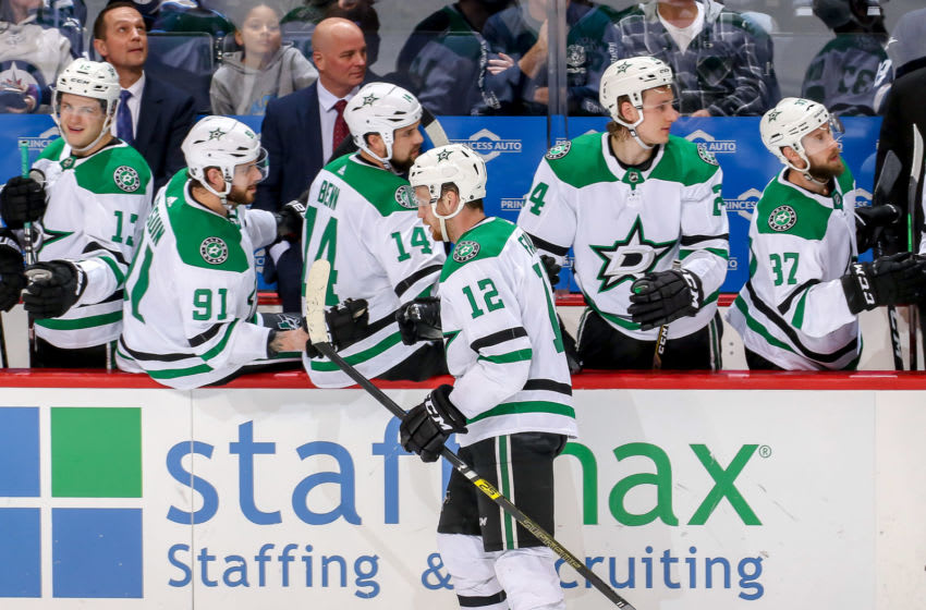 WINNIPEG, MB - MARCH 25: Radek Faksa #12 of the Dallas Stars celebrates his third period empty net goal against the Winnipeg Jets with teammates at the bench at the Bell MTS Place on March 25, 2019 in Winnipeg, Manitoba, Canada. (Photo by Jonathan Kozub/NHLI via Getty Images)