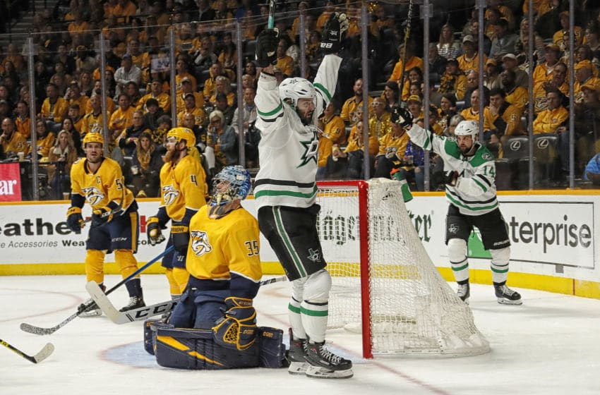 NASHVILLE, TENNESSEE - APRIL 20: Alexander Radulov #47 of the Dallas Stars celebrates with teammate Jamie Benn #14 after scoring a goal against goalie Pekka Rinne #35 of the Nashville Predators during the second period of Game Five of the Western Conference First Round during the 2019 NHL Stanley Cup Playoffs at Bridgestone Arena on April 20, 2019 in Nashville, Tennessee. (Photo by Frederick Breedon/Getty Images)