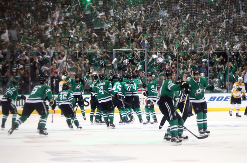 DALLAS, TEXAS - APRIL 22: The Dallas Stars celebrate the game winning goal against the Nashville Predators in overtime of Game Six of the Western Conference First Round during the 2019 Stanley Cup Playoffs at American Airlines Center on April 22, 2019 in Dallas, Texas. The Stars advanced to the next round of the 2019 Stanley Cup Playoffs. (Photo by Ronald Martinez/Getty Images)