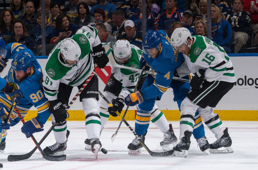 ST. LOUIS, MO - OCTOBER 5: Carl Gunnarsson #4 of the St. Louis Blues battles Tyler Seguin #91 Alexander Radulov #47 and Joe Pavelski #16 of the Dallas Stars for the puck at Enterprise Center on October 5, 2019 in St. Louis, Missouri. (Photo by Scott Rovak/NHLI via Getty Images)
