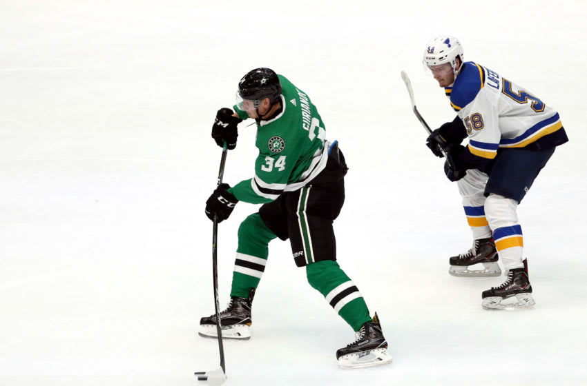 DALLAS, TEXAS - SEPTEMBER 16: Denis Gurianov #34 of the Dallas Stars skates the puck against Mathias Laferriere #58 of the St. Louis Blues in the third period during a NHL preseason game at American Airlines Center on September 16, 2019 in Dallas, Texas. (Photo by Ronald Martinez/Getty Images)