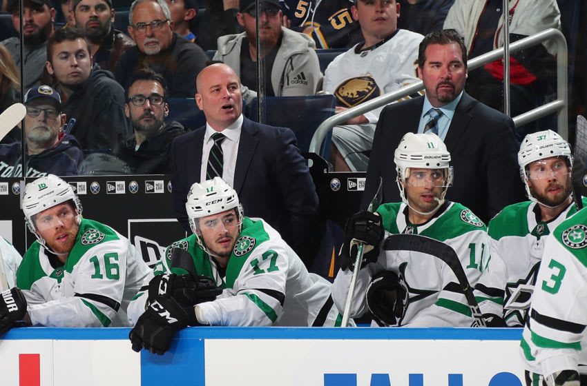 BUFFALO, NY - OCTOBER 14: Head coach Jim Montgomery of the Dallas Stars (left) watches the action during an NHL game against the Buffalo Sabres on October 14, 2019 at KeyBank Center in Buffalo, New York. Buffalo won, 4-0. (Photo by Bill Wippert/NHLI via Getty Images)