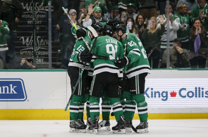 DALLAS, TX - NOVEMBER 05: Dallas Stars center Radek Faksa (12) celebrates scoring a goal with his teammates during the game between the Dallas Stars and the Colorado Avalanche on November 05, 2019 at the American Airlines Center in Dallas, Texas. (Photo by Matthew Pearce/Icon Sportswire via Getty Images)
