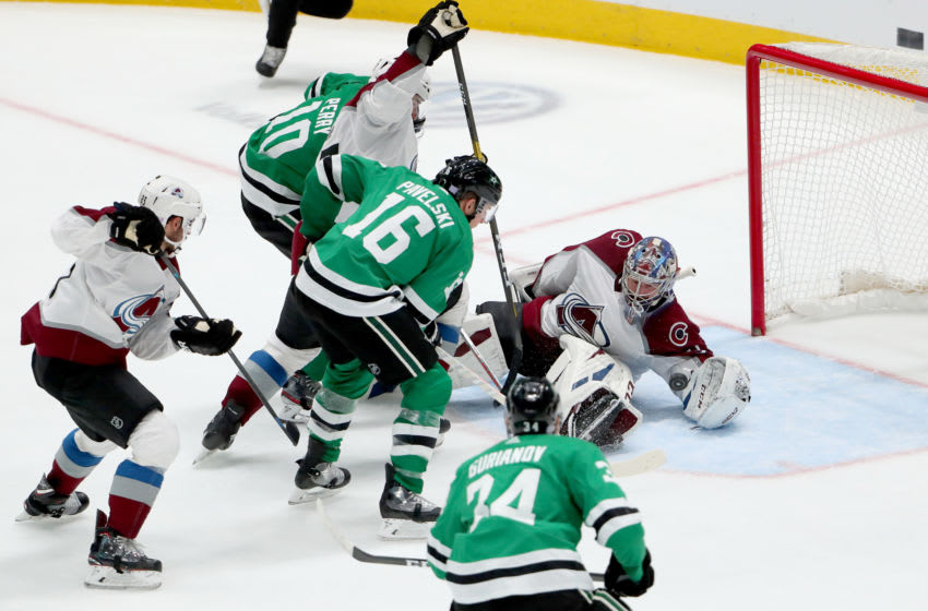 DALLAS, TEXAS - NOVEMBER 05: Philipp Grubauer #31 of the Colorado Avalanche blocks a shot on goal against Joe Pavelski #16 of the Dallas Stars in the second period at American Airlines Center on November 05, 2019 in Dallas, Texas. (Photo by Tom Pennington/Getty Images)