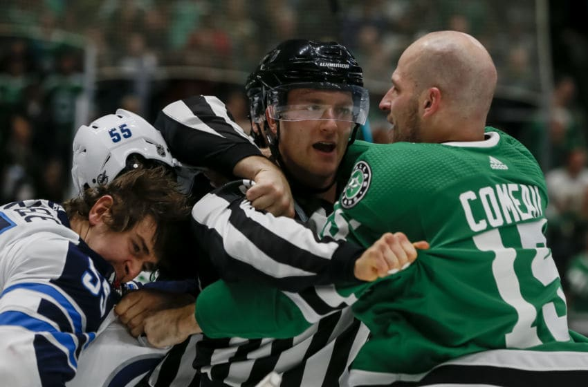 DALLAS, TX - DECEMBER 05: Dallas Stars left wing Blake Comeau (15) and Winnipeg Jets center Mark Scheifele (55) start throwing punches at each other during the game between the Dallas Stars and the Winnipeg Jets on December 05, 2019 at American Airlines Center in Dallas, Texas. (Photo by Matthew Pearce/Icon Sportswire via Getty Images)