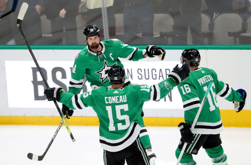 DALLAS, TEXAS - JANUARY 27: Jamie Benn #14 of the Dallas Stars celebrates with Blake Comeau #15 of the Dallas Stars and Joe Pavelski #16 of the Dallas Stars after scoring against the Tampa Bay Lightning in the third period at American Airlines Center on January 27, 2020 in Dallas, Texas. (Photo by Tom Pennington/Getty Images)