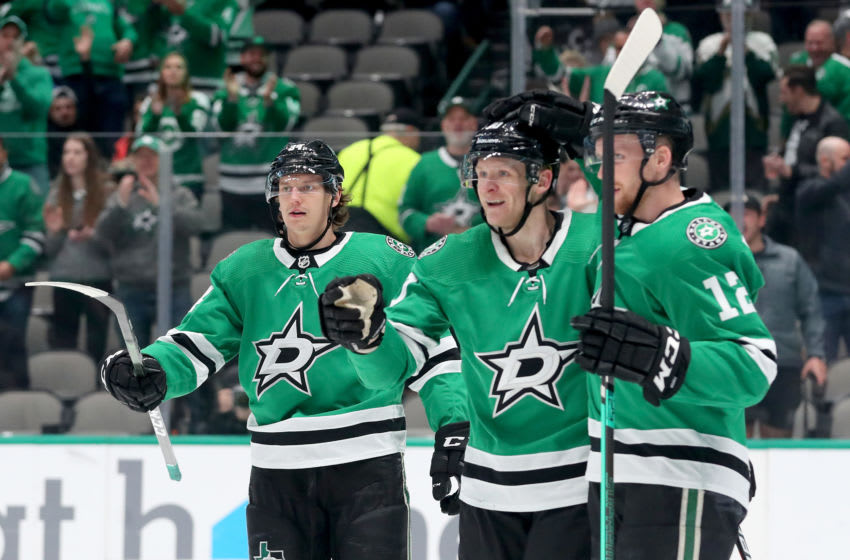 DALLAS, TEXAS - FEBRUARY 19: Corey Perry #10 of the Dallas Stars celebrates with Radek Faksa #12 of the Dallas Stars and Denis Gurianov #34 of the Dallas Stars after scoring a goal against Adin Hill #31 of the Arizona Coyotes in the first period at American Airlines Center on February 19, 2020 in Dallas, Texas. (Photo by Tom Pennington/Getty Images)