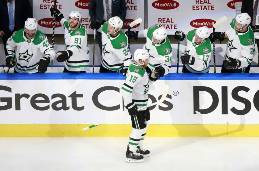 EDMONTON, ALBERTA - AUGUST 16: Joe Pavelski #16 of the Dallas Stars celebrates with his teammates after scoring a goal on Cam Talbot #39 of the Calgary Flames during the second period in Game Four of the Western Conference First Round during the 2020 NHL Stanley Cup Playoffs at Rogers Place on August 16, 2020 in Edmonton, Alberta, Canada. (Photo by Jeff Vinnick/Getty Images)