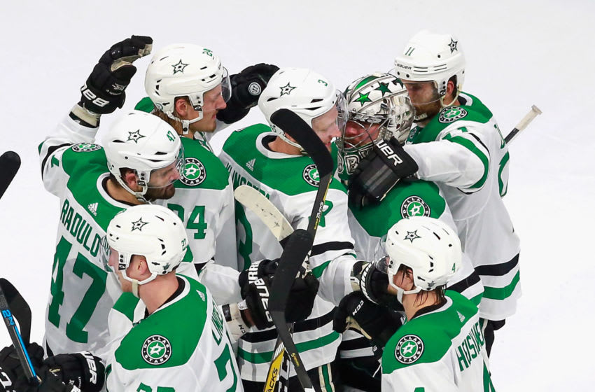 EDMONTON, ALBERTA - AUGUST 20: The Dallas Stars celebrate their victory over the Calgary Flames in Game Six of the Western Conference First Round during the 2020 NHL Stanley Cup Playoffs at Rogers Place on August 20, 2020 in Edmonton, Alberta, Canada. The Stars defeated the Flames 7-3 to win the Round One Western Playoff series 4-2. (Photo by Jeff Vinnick/Getty Images)