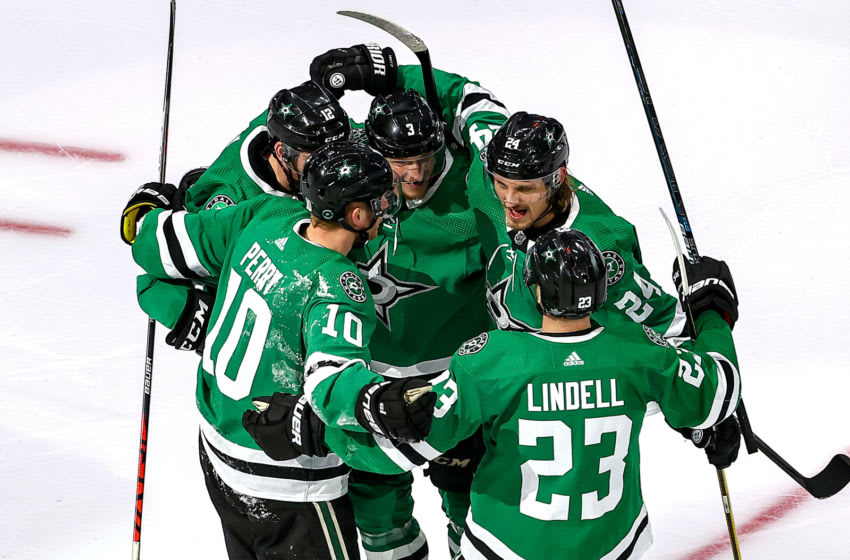 EDMONTON, ALBERTA - AUGUST 30: Roope Hintz #24 of the Dallas Stars is congratulated by his teammates after scoring a goal against the Colorado Avalanche during the third period in Game Four of the Western Conference Second Round during the 2020 NHL Stanley Cup Playoffs at Rogers Place on August 30, 2020 in Edmonton, Alberta, Canada. (Photo by Bruce Bennett/Getty Images)